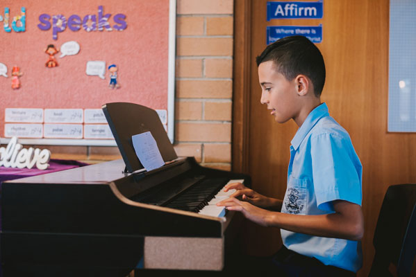 Student playing piano at St Mary Star of the Sea Catholic Primary School Hurstville