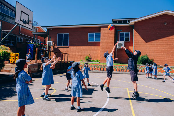Students playing basketball at St Mary Star of the Sea Catholic Primary School Hurstville