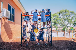 Students playing on modern play equipment at St Mary Star of the Sea Catholic Primary School Hurstville