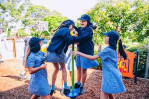 Students playing on play equipment at St Mary Star of the Sea Catholic Primary School Hurstville