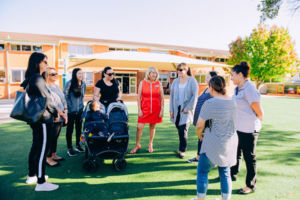 Teachers and parents standing chatting in front of St Mary Star of the Sea Catholic Primary School Hurstville