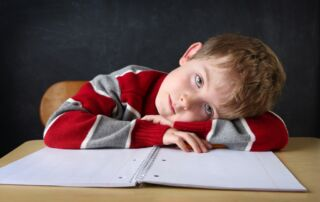 A boy studying at home